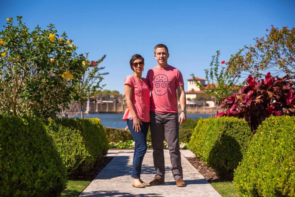 couple posing at Hollis Garden in Lakeland on Lake Mirror