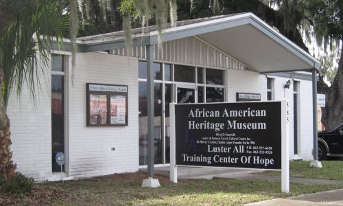 Exterior of entrance and sign at African American Heritage Museum and Luster All Training Center of Hope in Bartow, FL