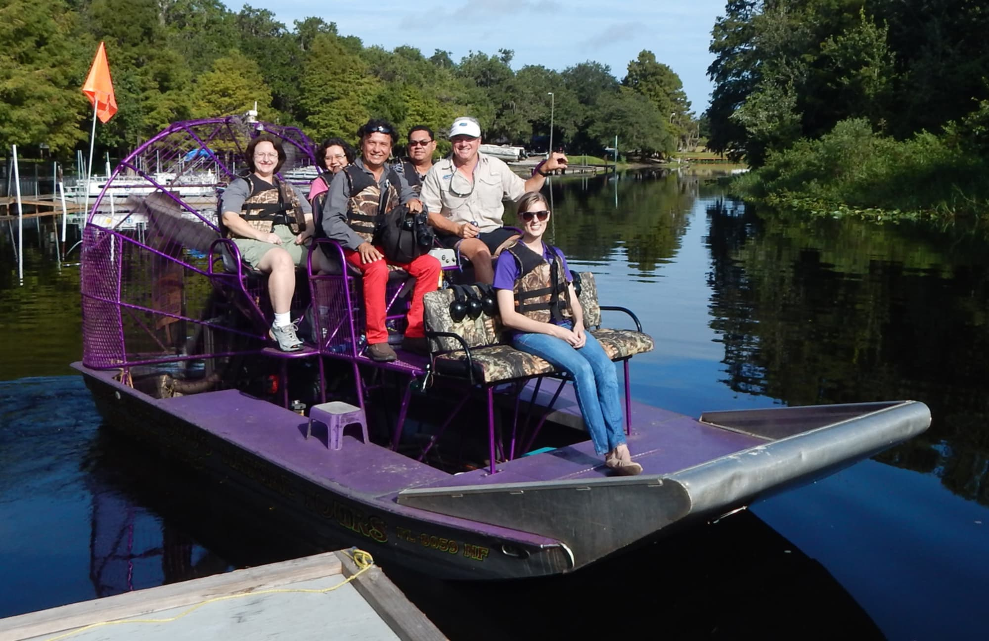 group on Alligator Cove Tours airboat tour in river near Lake Kissimmee