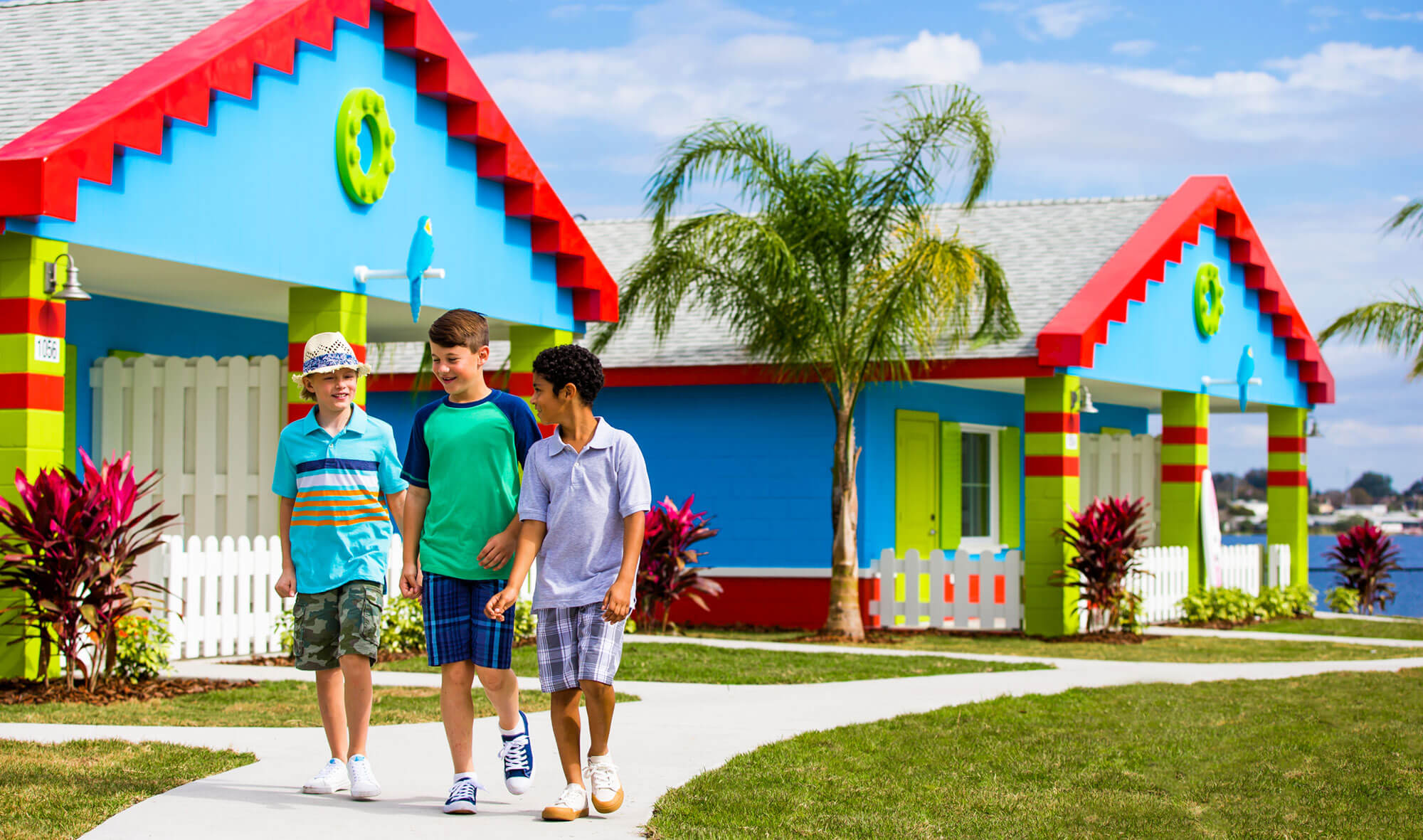Kids walking outside of Beach Retreat Bungalows at LEGOLAND Florida Resort in Winter Haven, FL