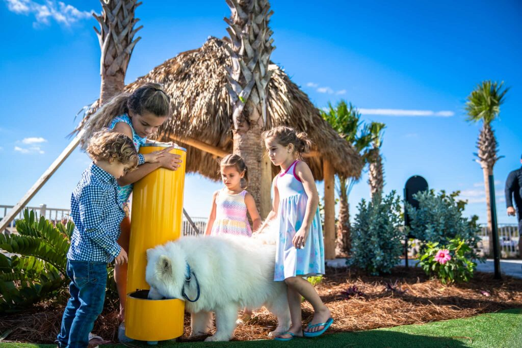 4 kids and a dog at a water fountain inside Cabana Club RV Resort in Auburndale FL