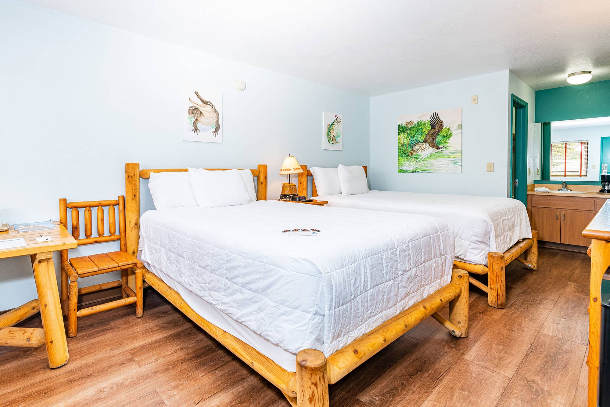 two beds in Double room at Camp Mack a Guy Harvey Lodge in Lake Wales