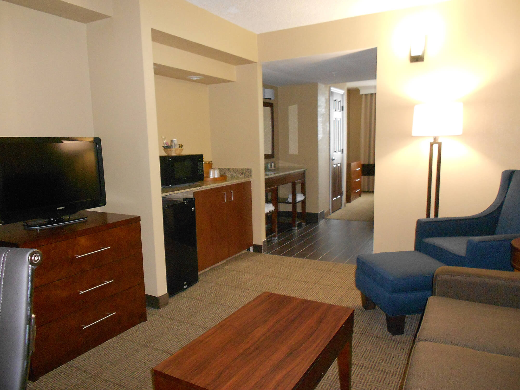 Sitting and kitchen areas of suite at Comfort Inn & Suites Lakeland North I4
