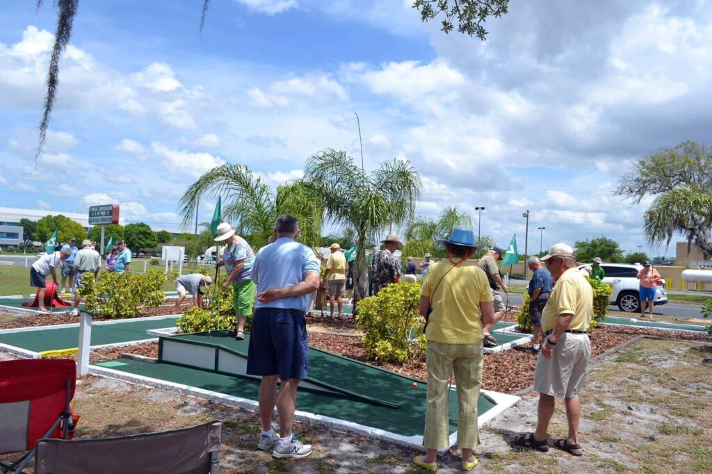 guests playing mini golf at Cypress Campground and RV Park in Winter Haven