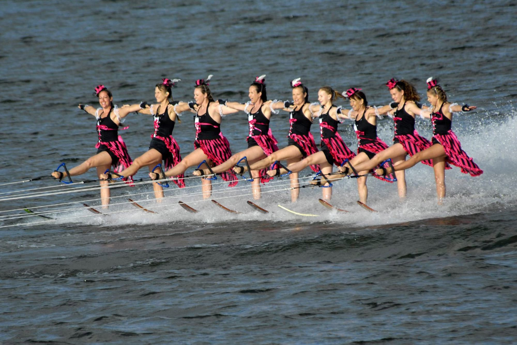 9 show ski females on lake in Winter Haven, FL during Cypress Gardens Water Ski Team show.