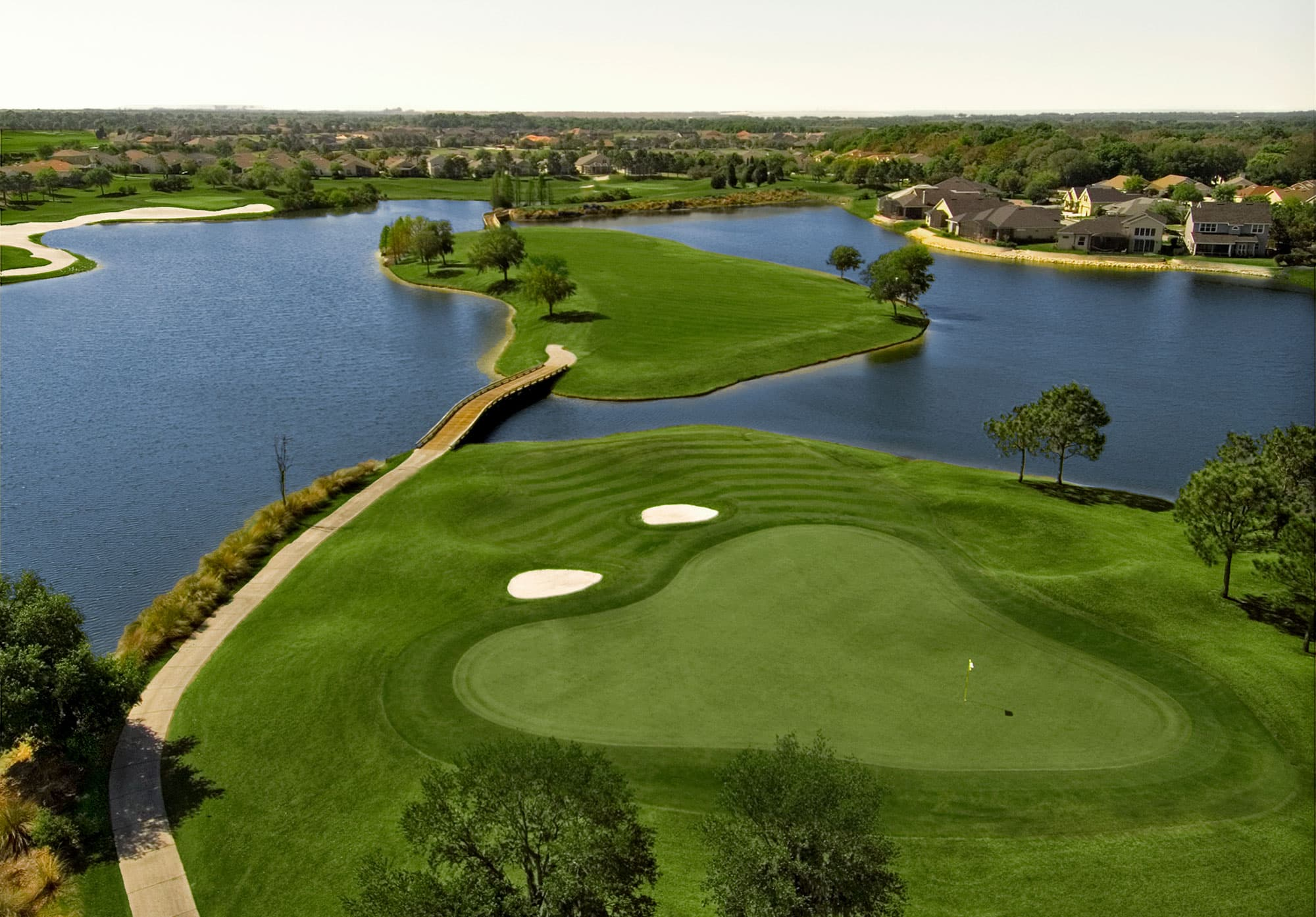 Par 3 hole featuring over the water shot to tee at Eaglebrooke Golf & Country Club in Lakeland, FL