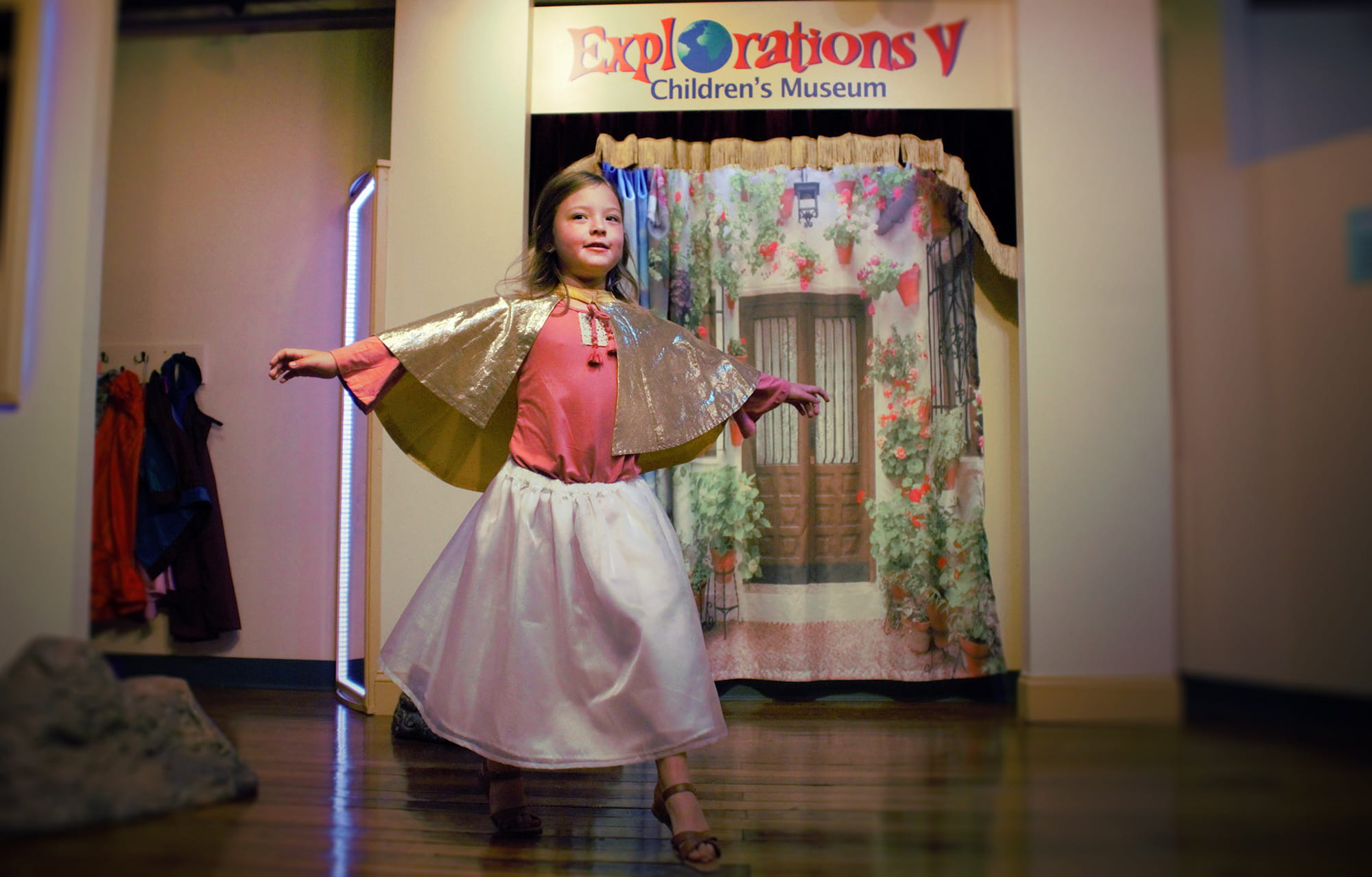 Child playing in costume and on stage at Explorations V Children's Museum in Lakeland, FL
