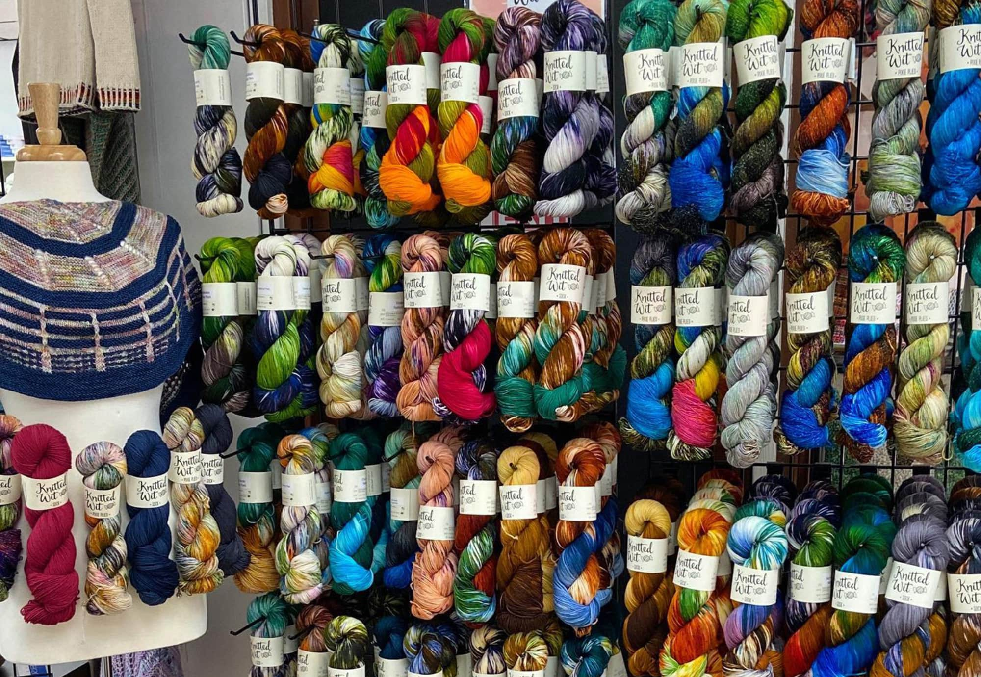 wall of colorful twisted yarn bundles at Four Purls Yarn Shop in Winter Haven, FL