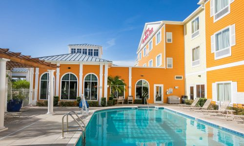Pool and hotel exterior at Hilton Garden Inn Lakeland