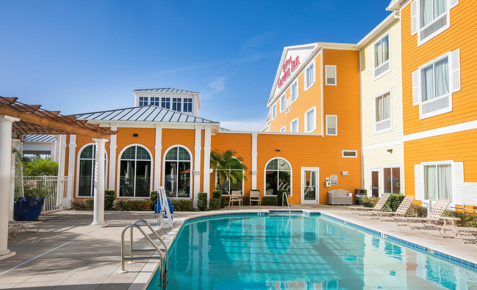 Pool and hotel exterior at Hilton Garden Inn Lakeland