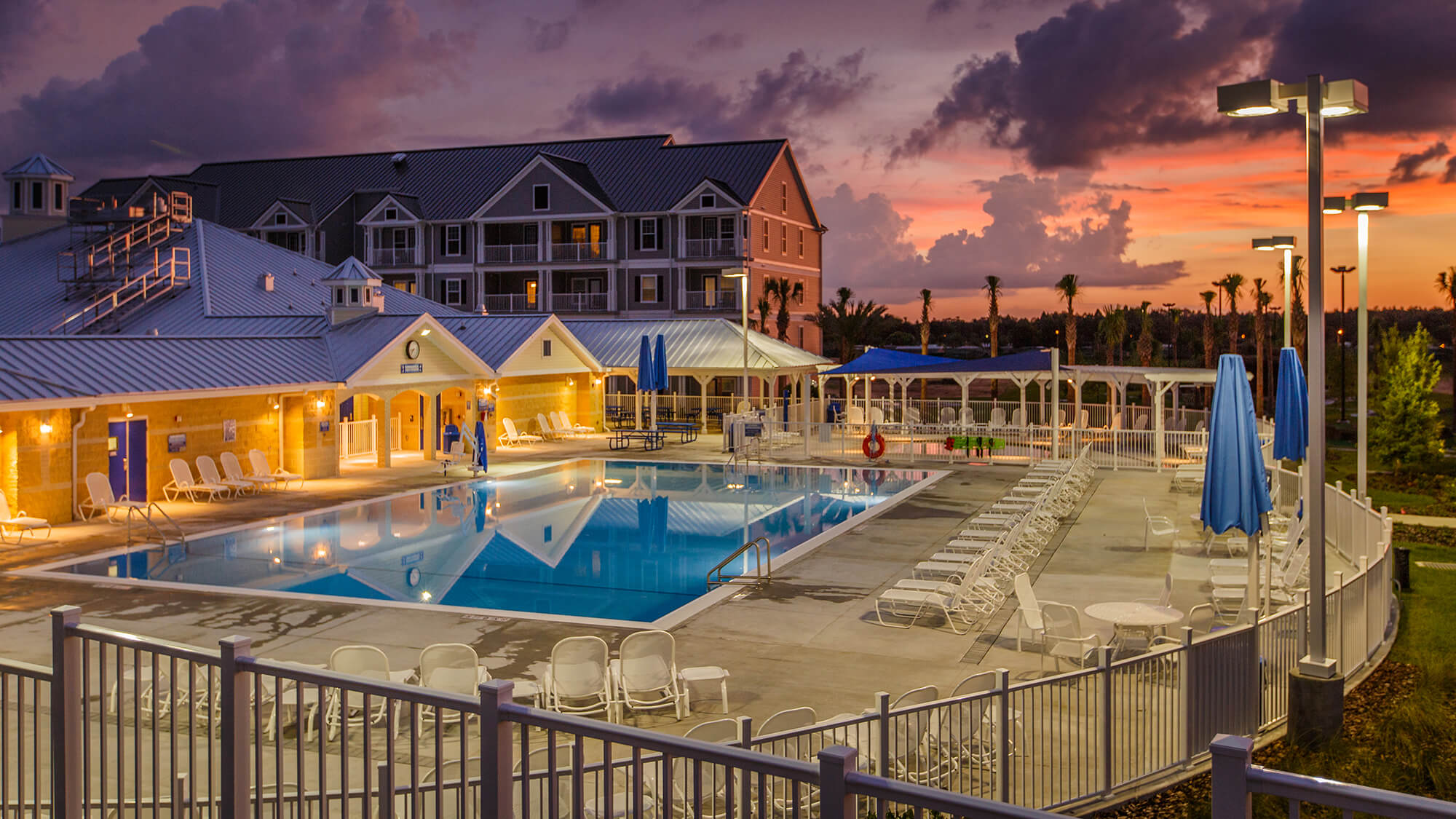 Pool, pool deck and exterior of Holiday Inn Club Vacations Orlando Breeze Resort in Davenport, FL