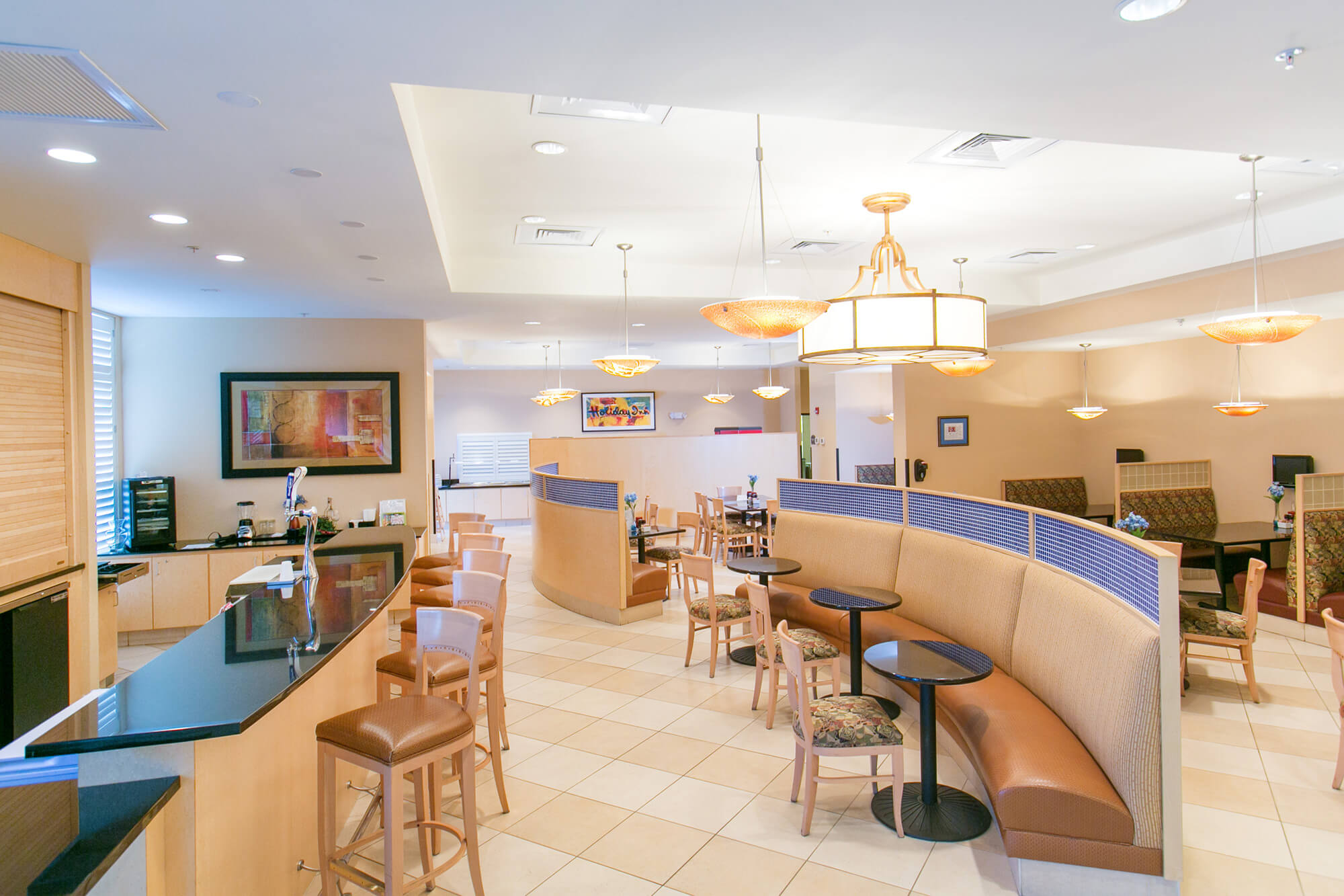 Dining, bar and sitting area inside Holiday Inn Winter Haven