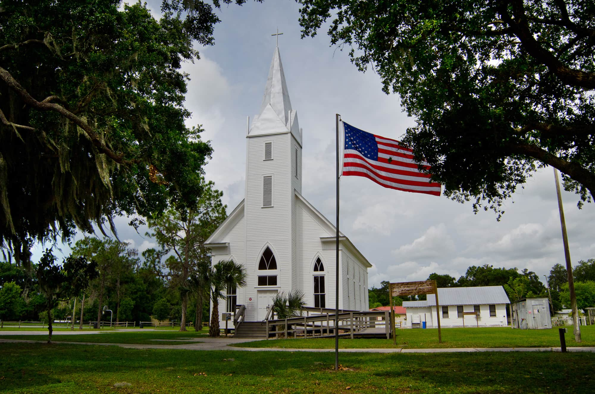 Church and US flag at Homeland Heritage Park near Bartow, FL