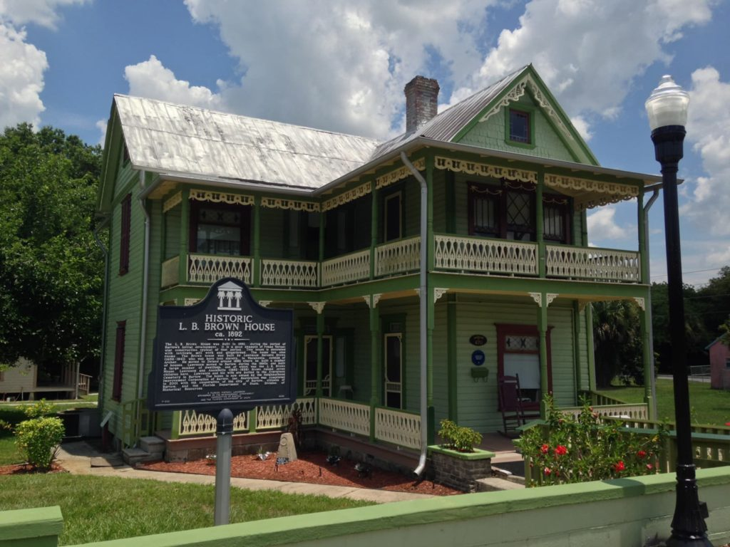 Exterior of LB Brown House Museum and historical marker sign in Bartow, FL.