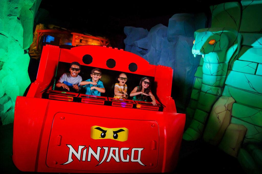 4 kids on NINJAGO ride at LEGOLAND Florida Resort in Winter Haven