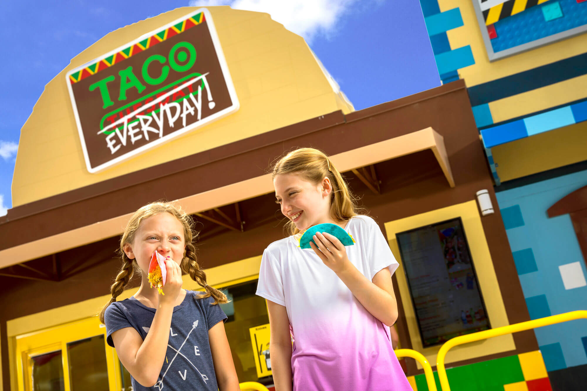 2 girls outside Taco Everyday restaurant in LEGO Movie World at LEGOLAND Florida Resort in Winter Haven