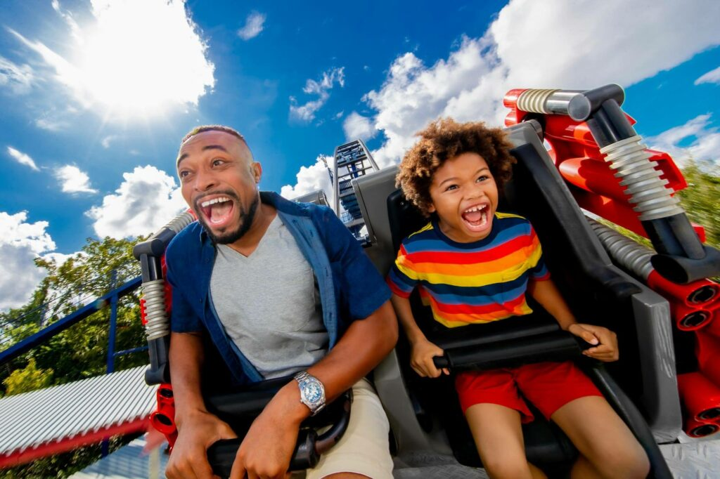 father and son on Great LEGO Race roller coaster at LEGOLAND in Winter Haven, FL