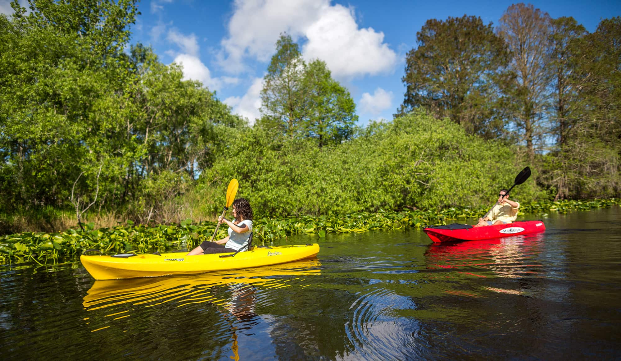 male and female kayaking at Lake Kissimmee State Park in Lake Wales, FL