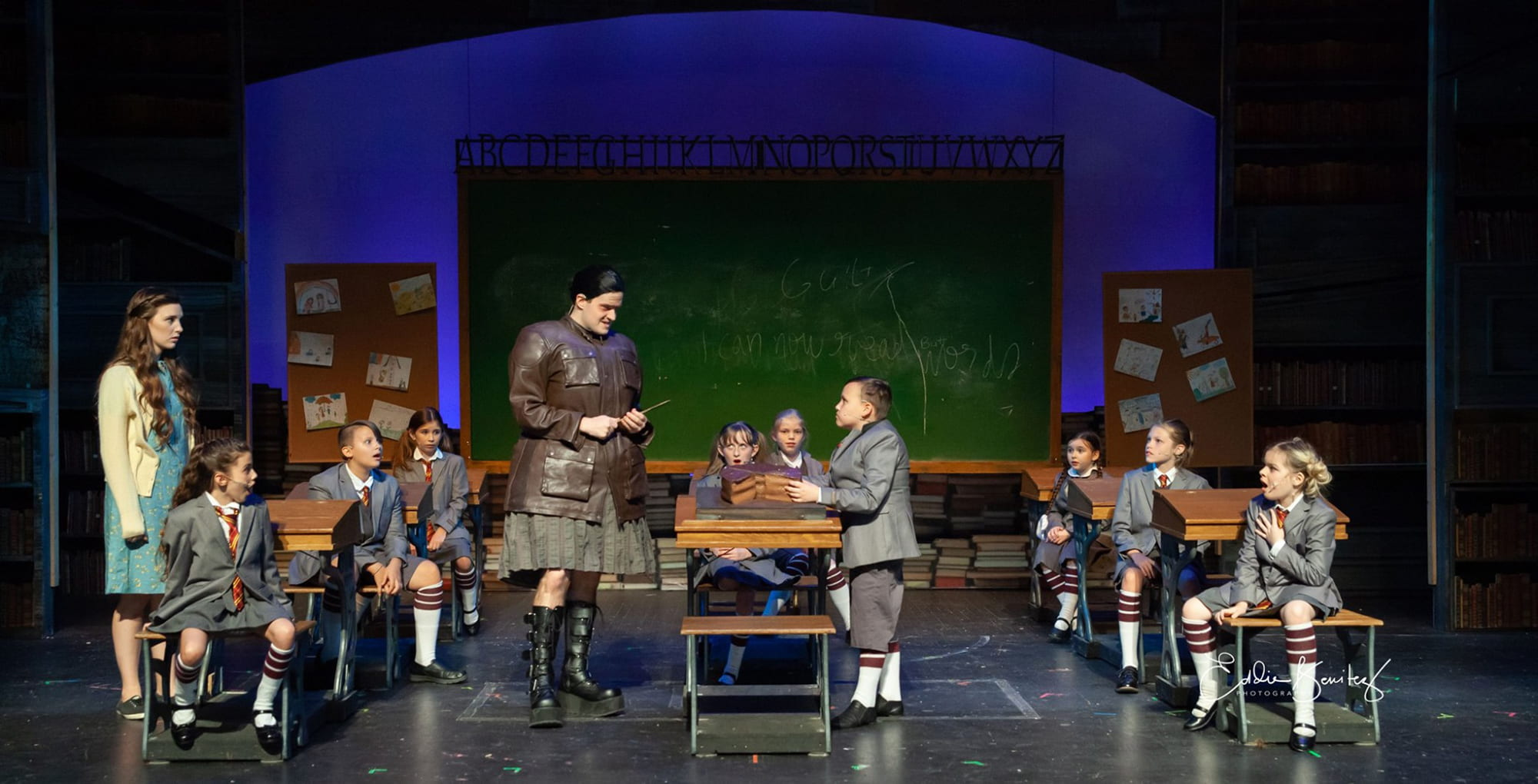 Actors on stage during a performance of Matilda at Lakeland Community Theatre.