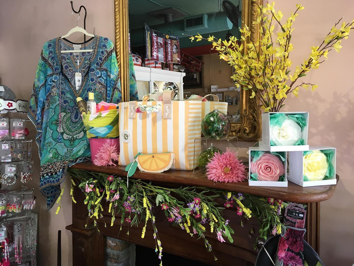 wooden mantel with flowers and merchandise on it at Little Studios Interiors in Winter Haven, FL