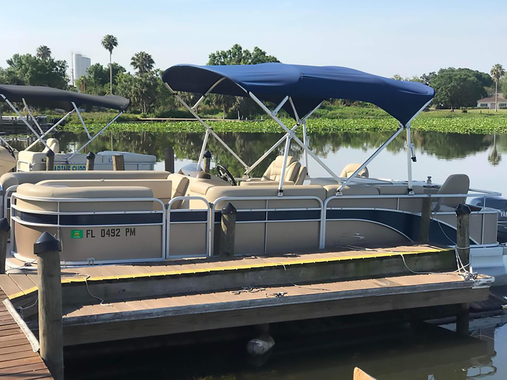 rental pontoon boat on lake at dock