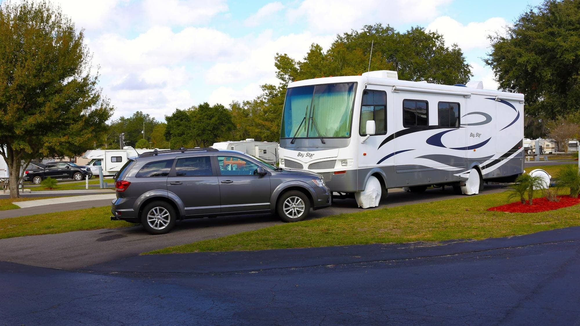 RV and SUV in paved site at Mouse Mountain RV and Camping in Davenport, FL