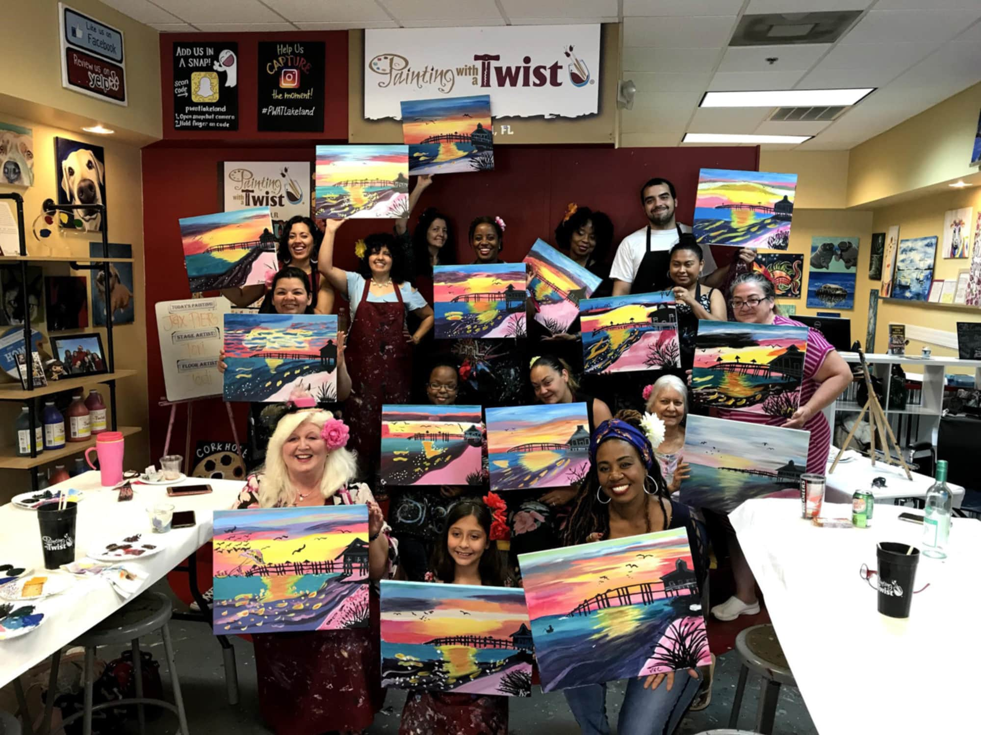 Group with finished paintings at Painting with a Twist in Lakeland, FL