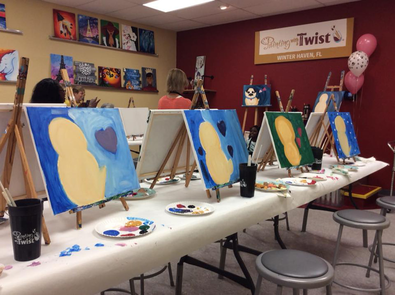 Participant paintings on table during class at Painting with a Twist in Winter Haven, FL