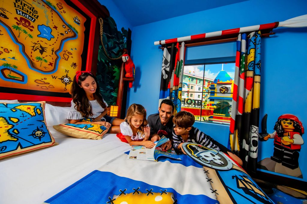 Family in LEGOLAND Pirate Island Hotel guest room in Winter Haven, FL