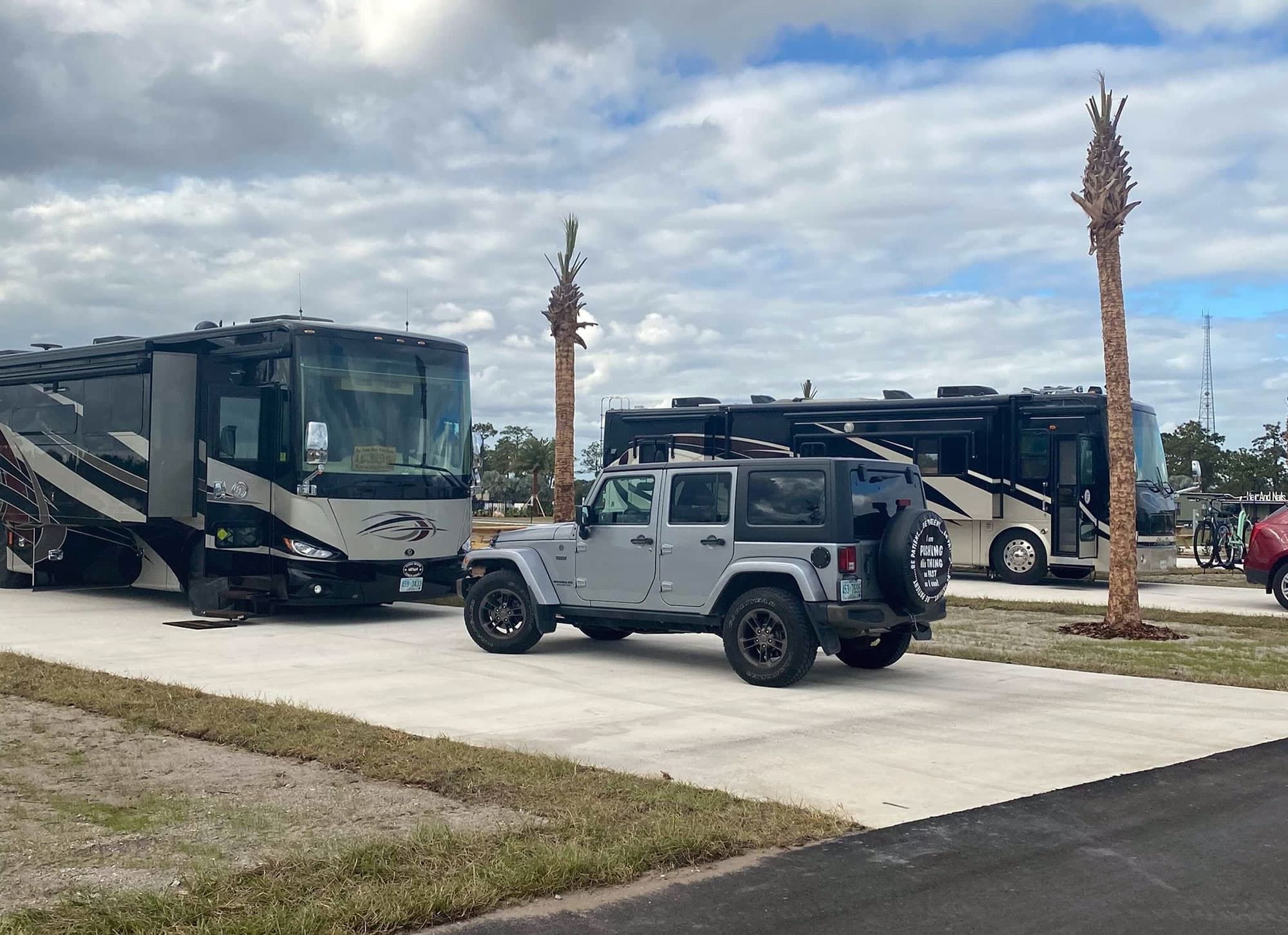 2 motorhomes and personal vehicles parked in oversized RV sites at Resort at Canopy Oaks in Lake Wales FL