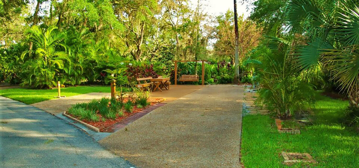 shaded premium RV site at River Ranch RV Resort in Lake Wales, FL