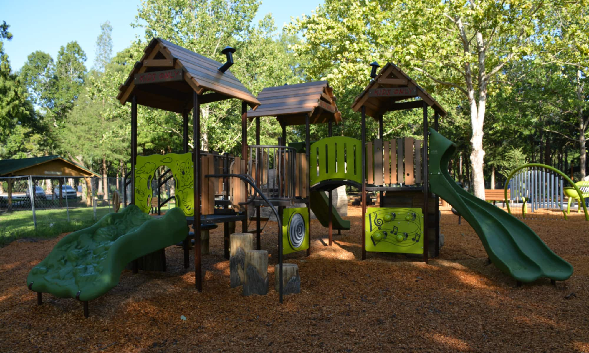 Playground equipment, including slides and stairs, at Rotary Playground at Hernando's Landing at Lake Parker Park in Lakeland, FL