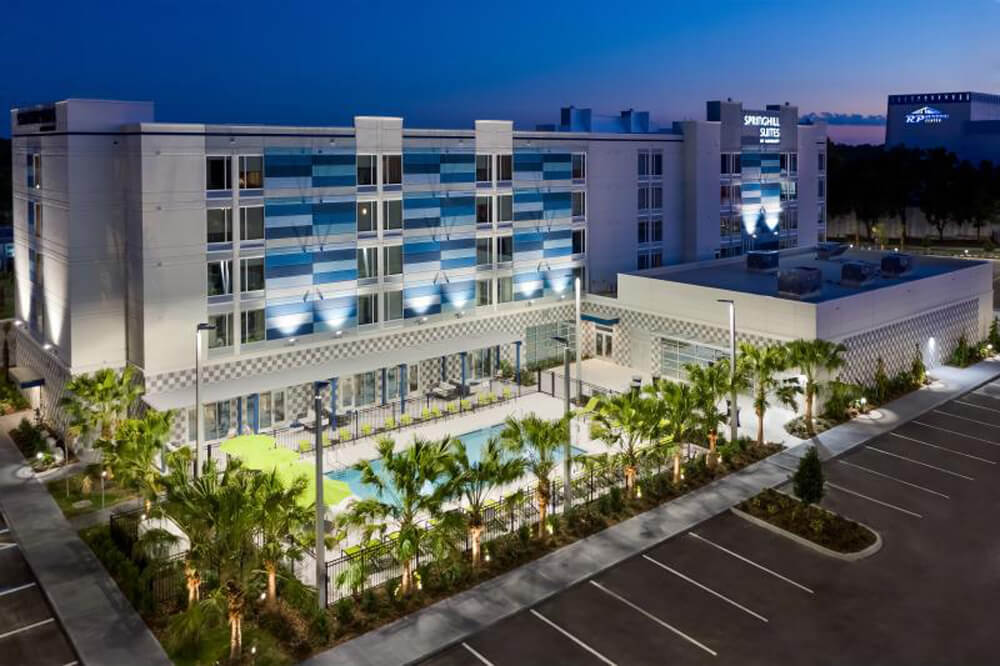 Exterior of SpringHill Suites by Marriott Lakeland hotel building and pool area
