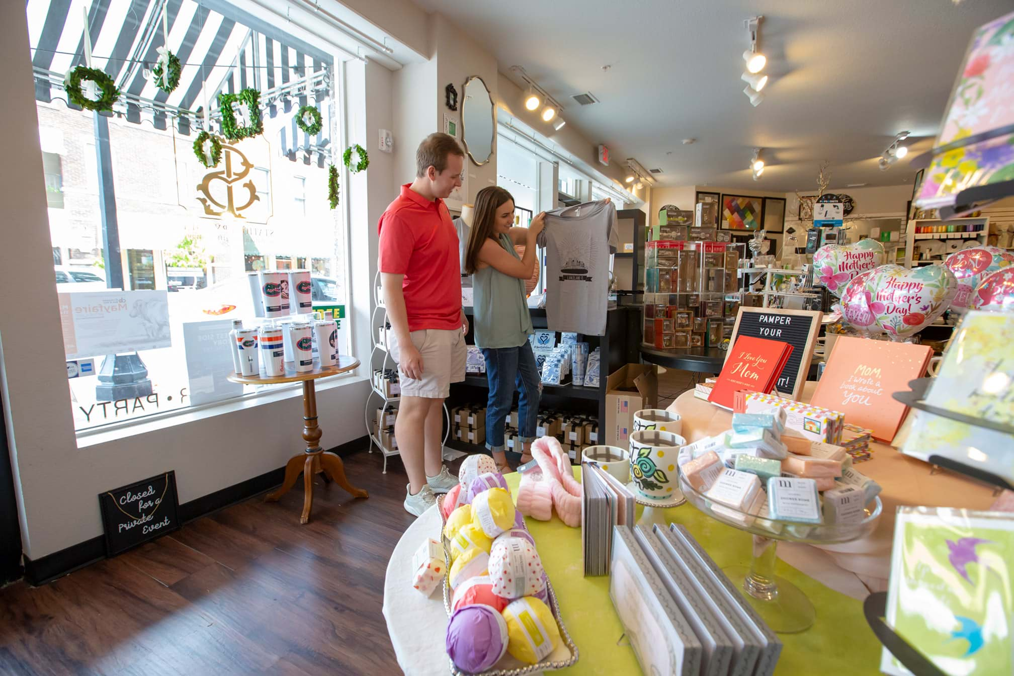 Couple looking at Lakeland themed t-shirt inside Stationery Loft and Gift Boutique in Lakeland, FL