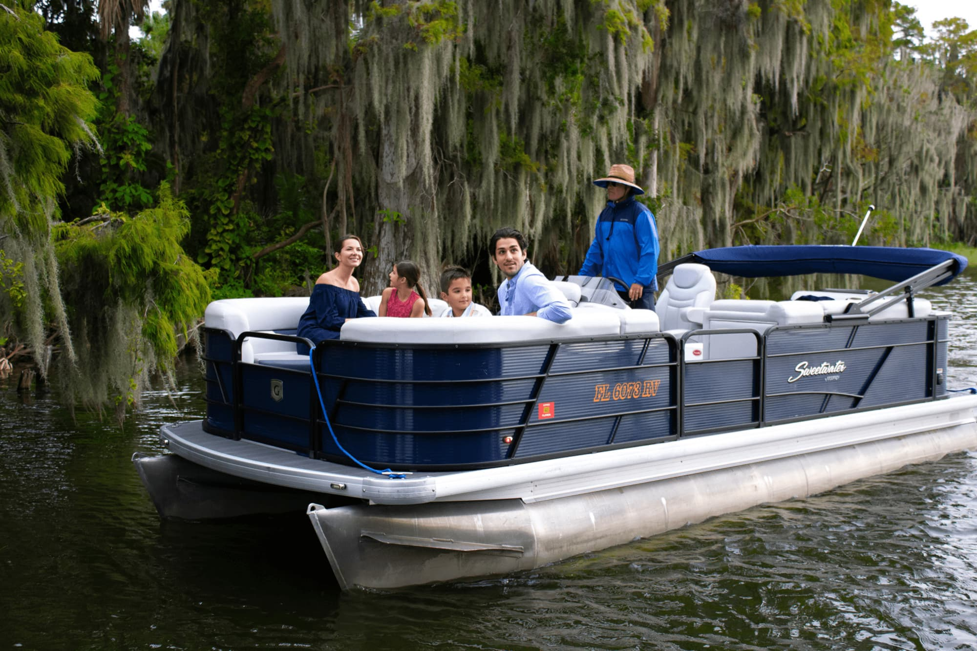 family of four on pontoon boat during tour with The Living Water Boat Cruises in Winter Haven, FL