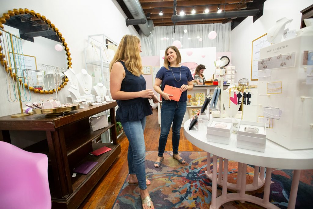 2 females looking at a coral clutch near a jewelry display at The Shop in Winter Haven, FL