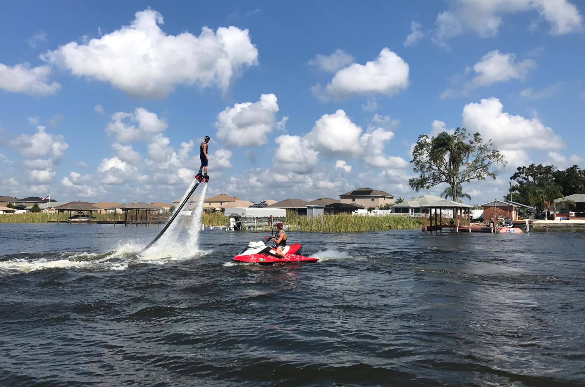man flyboarding with jet ski tow on lake at Winter Haven Watersports
