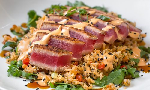 blackened tuna over rice at Harry's Seafood Bar and Grille in Lakeland, FL