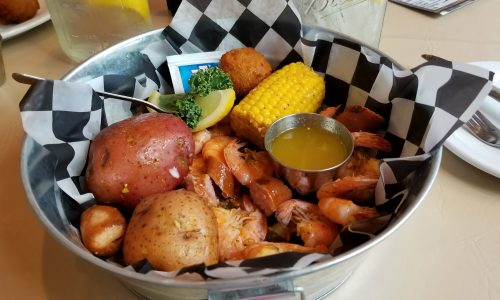potatoes, corn on the cob, shrimp and butter. Seafood boil bowl at Harry's Old Place in Winter Have, FL