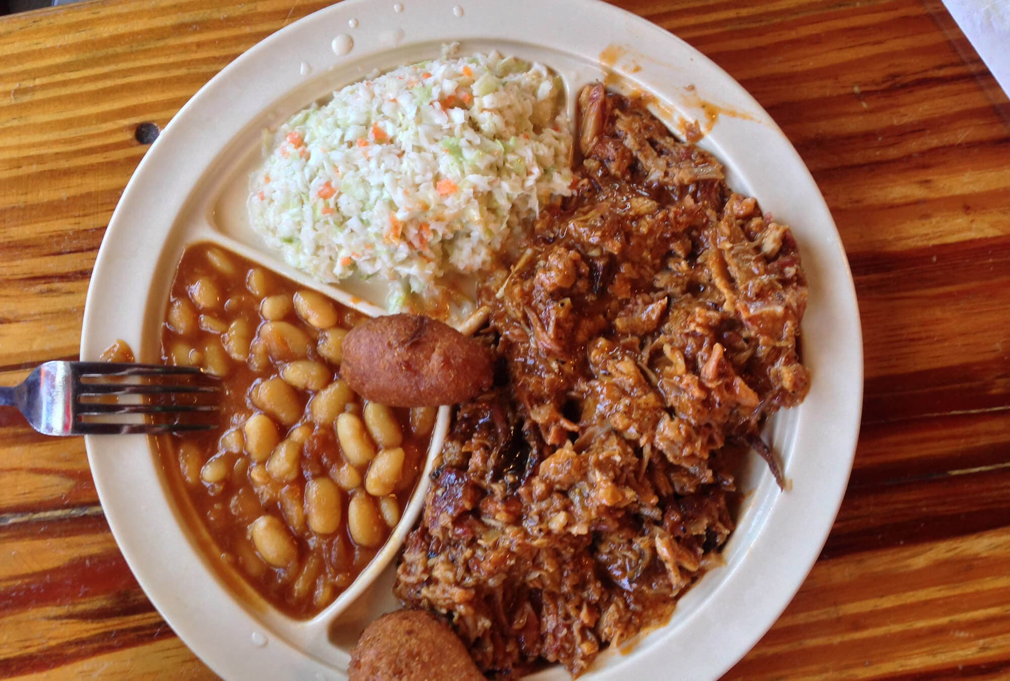 plate of pulled pork, baked beans, cole slaw and hush puppies at Jimbo's Pit Bar-B-Q in Lakeland, FL