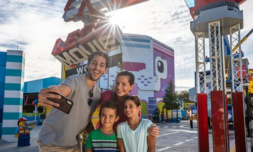 Family taking selfie in front of LEGO Movie World