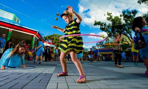 kid wearing a honey bee costume, hula hooping at LEGOLAND Florida Resort