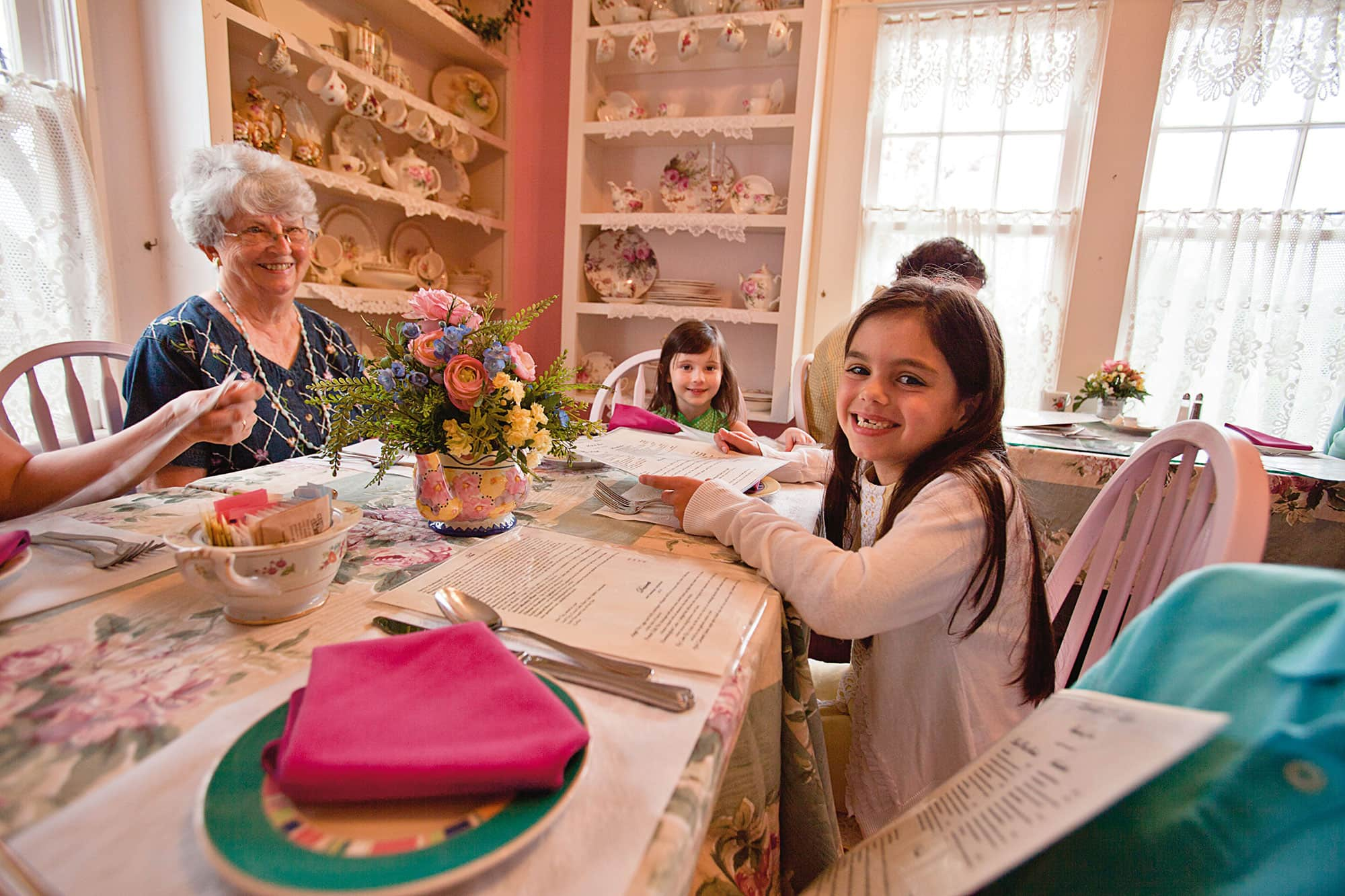 Young girl having lunch with grandma and siblings at Lavender N Lace Tea Room in Lake Alfred, FL