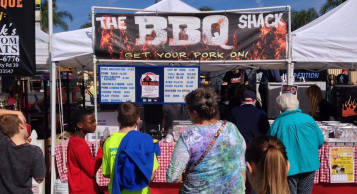 people standing in line for barbecue at Lakeland PigFest