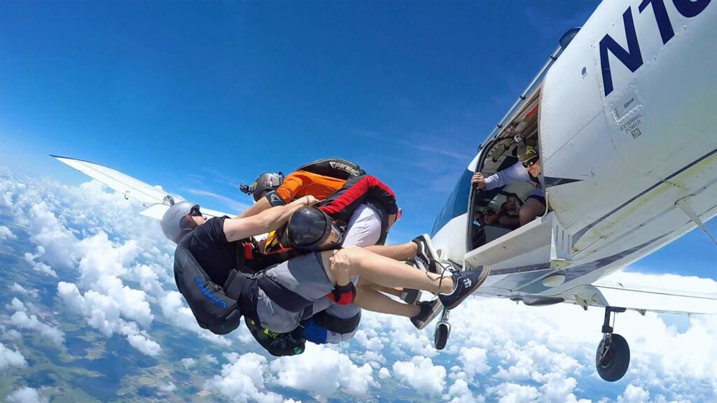 3 jumpers coming out of plane, mid air, at Jump Florida Skydive in Lake Wales, FL