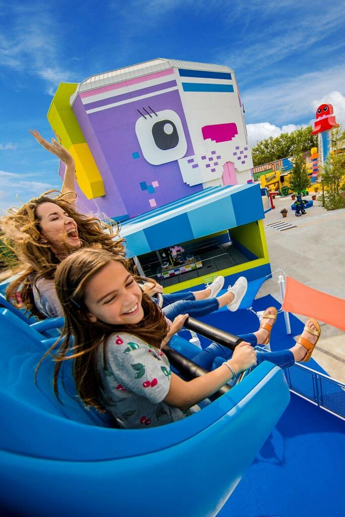 mom and daughter on LEGO Movie World ride at LEGOLAND Florida Resort in Winter Haven, FL