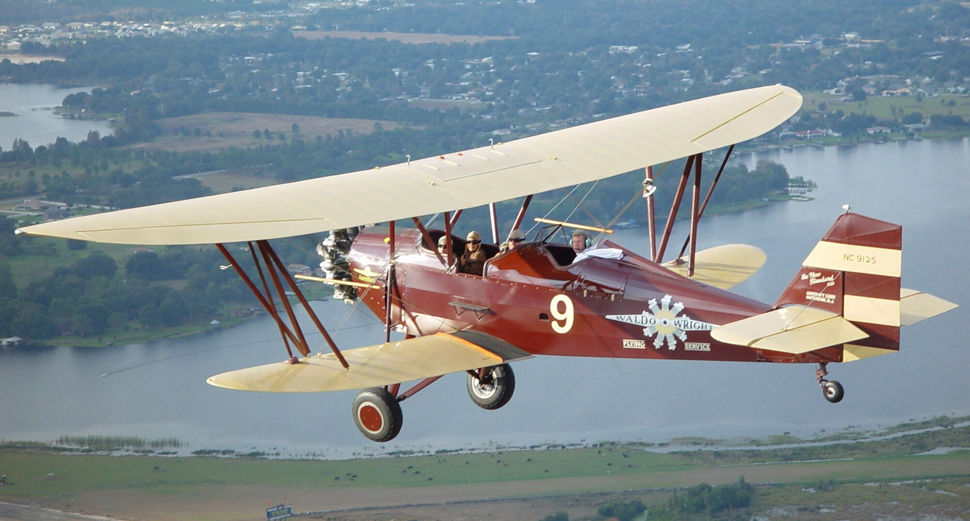Standard D-25 in flight during biplane ride at Waldo Wright's Flying Service in Central Florida