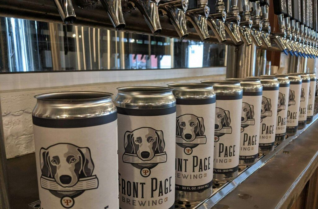 Front Page Brewing Co crowlers lined up under taps