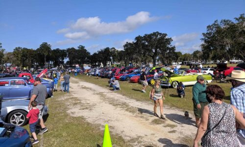People looking at cars during Holiday Flying Festival and Car Show at SUN 'n FUN in Lakeland, FL