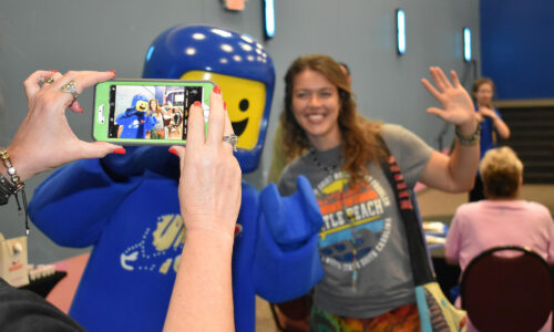 CATS training session attendee taking photo with LEGOLAND Florida Resort character